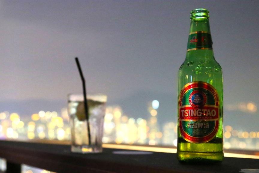 Wooloomooloo outlook and local beer Tsingtao, Wan Chai, Hong Kong