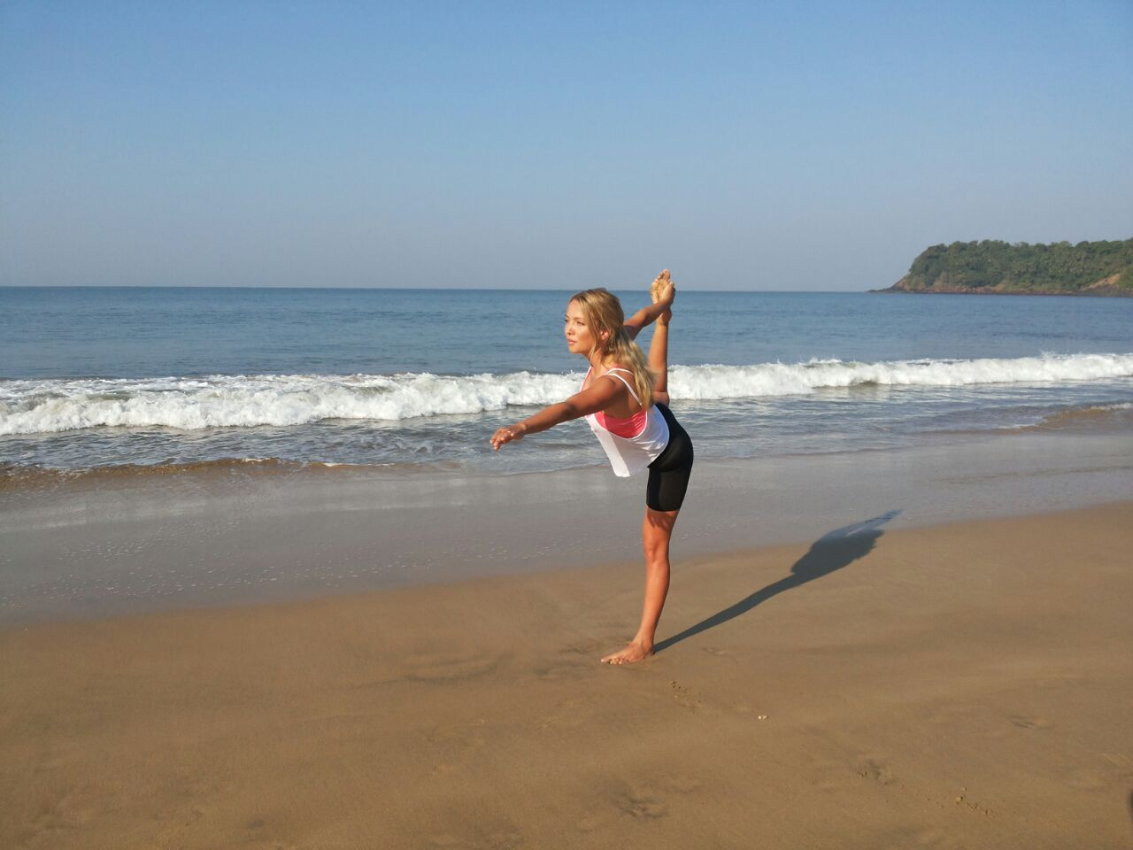 Girl teaching Yoga Goa, India