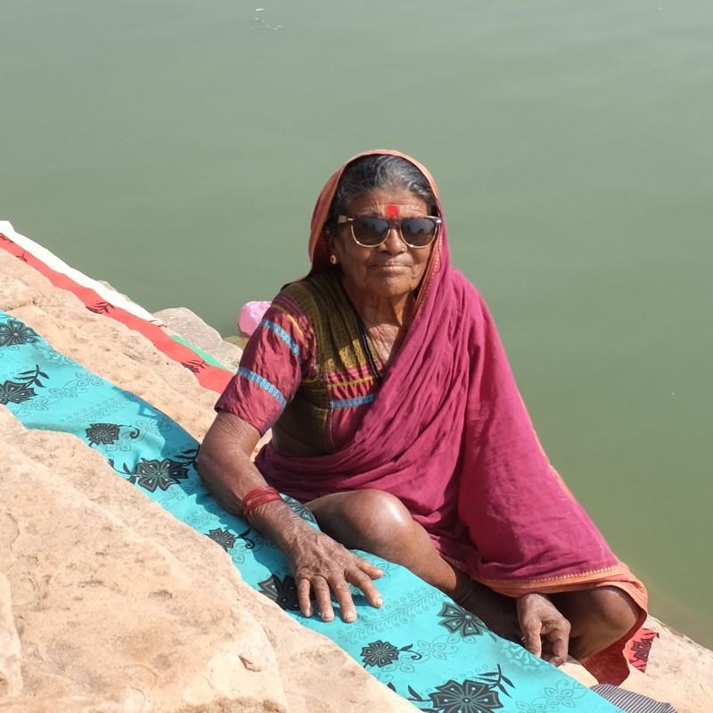 Lady washing clothing India